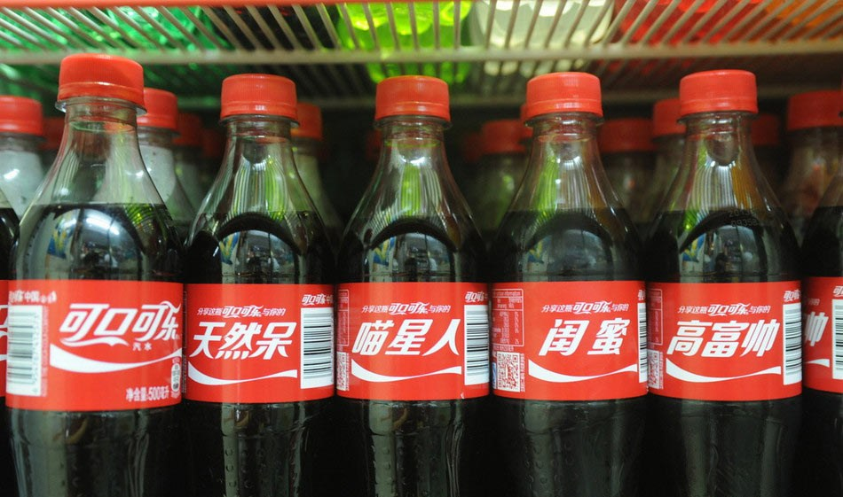 Coke bottles' buzzwords attract youth.[File photo]