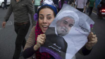 Hassan Rouhani's supporters celebrate election victory