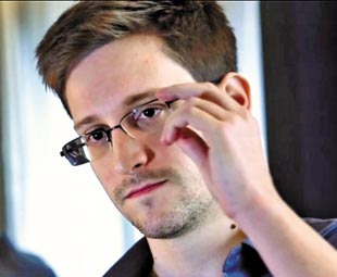 China dismisses claims of Snowden spying