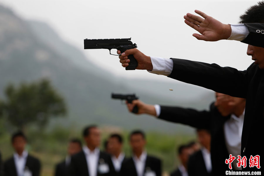 Future bodyguards receive tactical shooting training - China