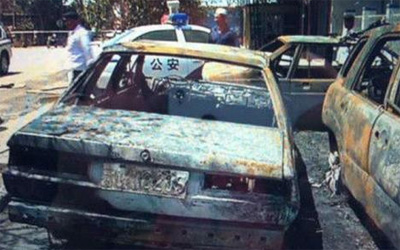 The rioters set fire to multiple cars at the police station and killed 24 people at Lukqun Township in northwest China's Xinjiang Uygur Autonomous Region on June 26.