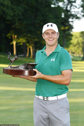 Jordan Spieth holds the trophy after winning a three way five hole sudden death playoff after the final round of the John Deere Classic held at TPC Deere Run on July 14, 2013 in Silvis, Illinois.