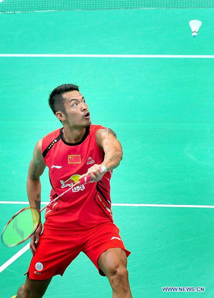 Lin Dan of China returns a shot during the men's singles 1st round match against Sattawat Pongnairat of the United States at the 2013 BWF World Championships on Aug. 5, 2013.