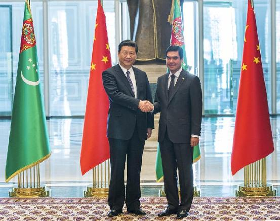 Visiting Chinese President Xi Jinping (L) shakes hands with his Turkmenian counterpart Gurbanguly Berdymukhamedov prior to their meeting in Ashkhabad, capital of Turkmenistan, Sept. 3, 2013. [Wang Ye/Xinhua]
