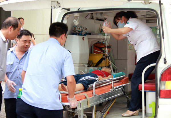 Feng Jie, 14, the youngest among three people injured at a fairground in Xi'an, is loaded into an ambulance for transportation to a hospital on Sunday. Dou Yiming / for China Daily