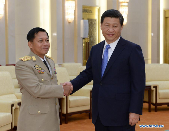 Chinese President Xi Jinping (R), who is also chairman of China's Central Military Commission, shakes hands with Myanmar's Commander-in-Chief of the Defense Services Senior-General Min Aung Hlaing during their meeting in Beijing, capital of China, Oct. 16, 2013.