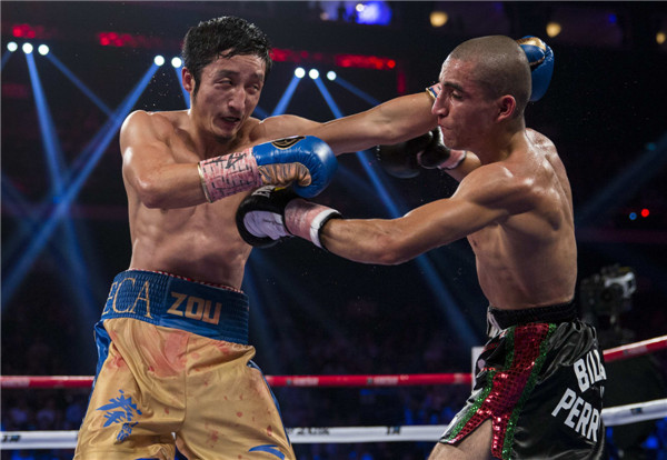 China's Zou Shiming wins third pro bout