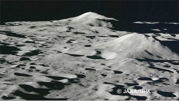 Just moments before impact, Kaguya's HD camera took this picture. Lunar hills loom in a seemingly distant background.[Space.com]