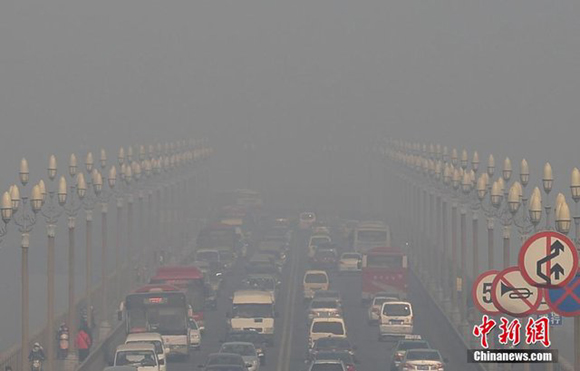 Heavy smog and fog hit Nanjing, Jiangsu Province, on Dec. 4, 2013.