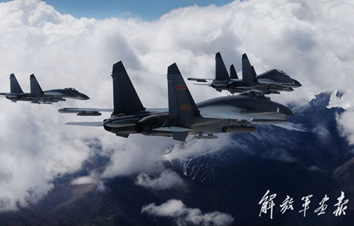 Chinese fighter jets fly over snowy mountains- China org cn