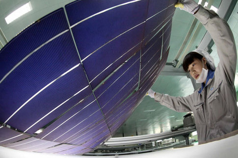 An inspector checks photovoltaic products bound for the US at a plant in Lianyungang, Jiangsu province. US solar panel producer SolarWorld Industries America Inc is lobbying Washington to levy anti-dumping and anti-subsidy tariffs on Chinese solar products. [China Daily]