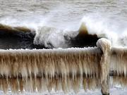 Photo taken on Feb. 10, 2014 shows a frozen guardrail in the seaside Weihai Park in Weihai, east China's Shandong Province, Feb. 10, 2014. Cold air hit parts of Shandong, where the temperatures dropped to ten degrees Celsius below zero. [Xinhua]