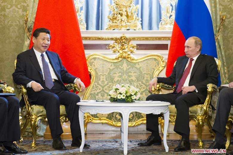Visiting Chinese President Xi Jinping (L) and his Russian counterpart, Vladimir Putin, met Friday, March 22, 2013 in Moscow. Russia is the first leg of Xi's four-nation visit that also includes South Africa, Tanzania and the Republic of Congo. [Photo: Xinhua]