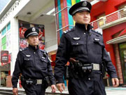 Shanghai police carry guns on patrol for first time