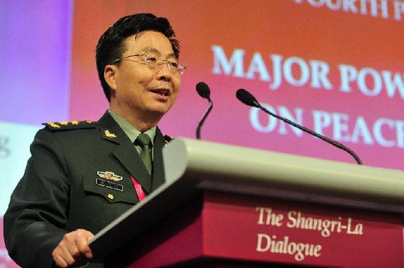 Wang Guanzhong, deputy chief of the General Staff of the Chinese People's Liberation Army, speaks during the fourth plenary session of the 13th Shangri-La Dialogue in Singapore June 1, 2014, the final day of the multilateral forum focusing on security issues in Asia. [Then Chih Wey/Xinhua]