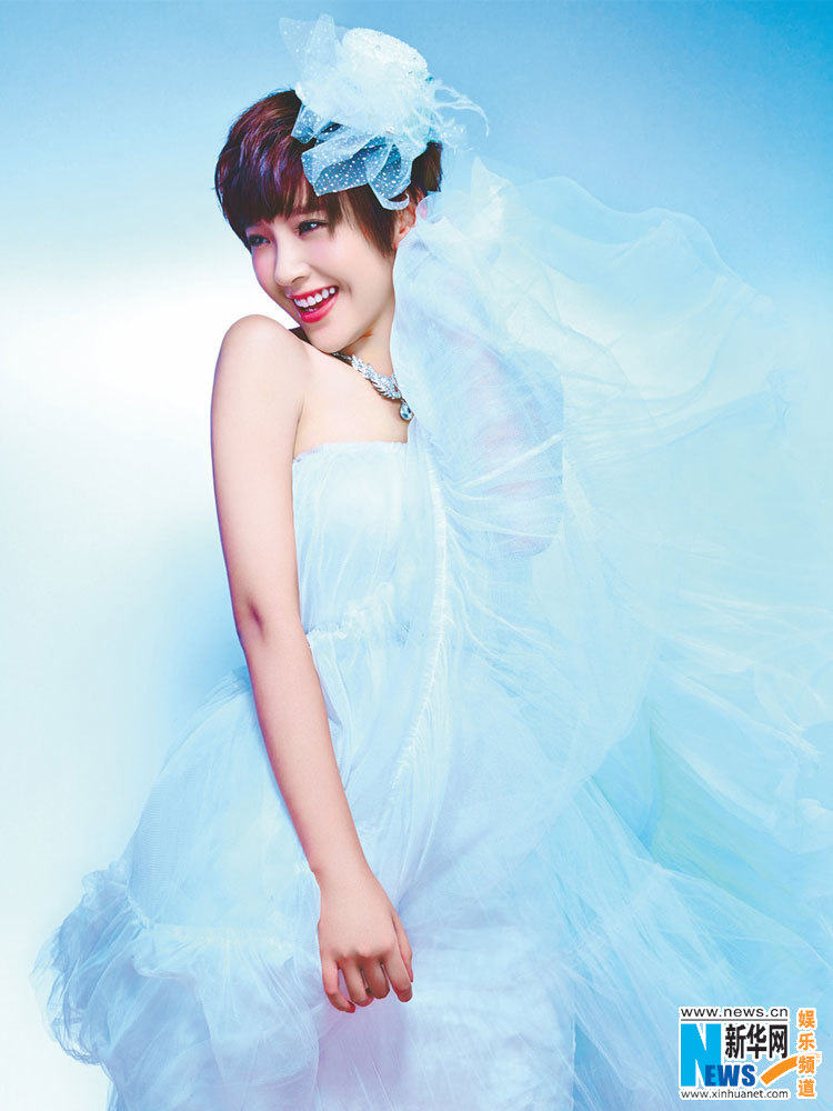 Cute girl Tang Yixin in wedding dress- China.org.cn