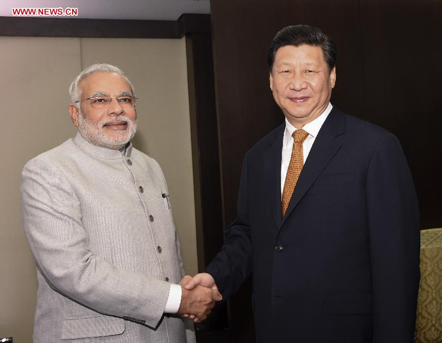 Chinese President Xi Jinping(R) meets with Indian Prime Minister Narendra Modi in Fortaleza, Brazil, July 14, 2014. [Photo/Xinhua]