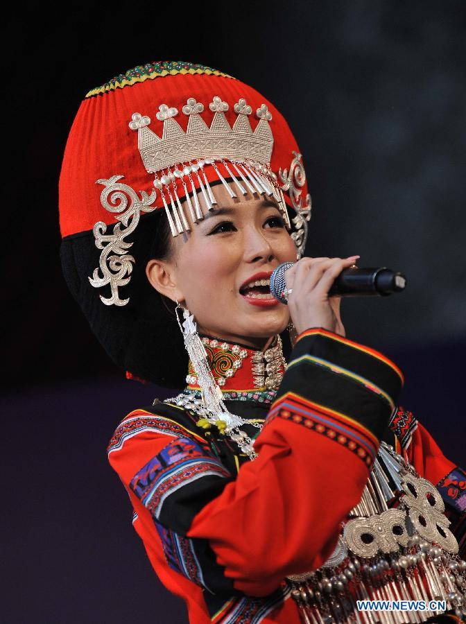 A woman of the Yi ethnic group performs during a talent show of a traditional beauty contest at Xichang City, southwest China's Sichuan Province, July 23, 2014.