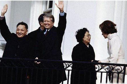 Deng Xiaoping (1st L) and former U.S. President Jimmy Carter (2nd L) wave to people during Deng's visit to the U.S. in 1979. [file photo]