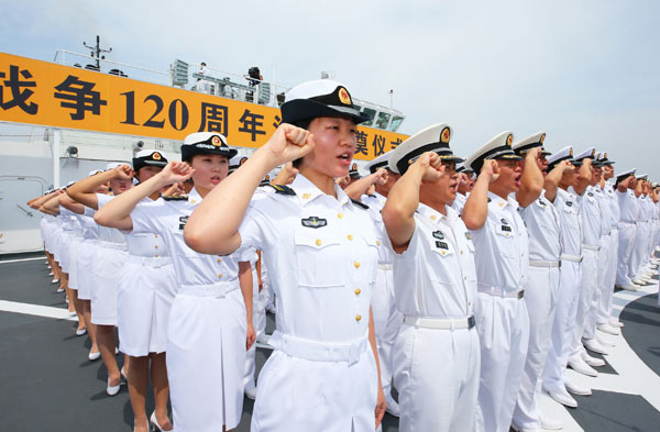 Sailors on a PLA navy cruiser take an oath on Aug 27 off the coast of Weihai, Shandong province. That day marked the 120th year of the start of the First SinoJapanese War (also called the Jiawu War) in 1894. The PLA navy, for the first time in its history, held a maritime memorial ceremony. CHA CHUNMING / XINHUA