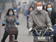 Beijing elevates air pollution alert to orange
