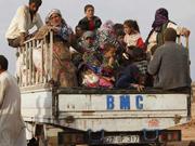Refugees flee from battle in Kobane to Turkey
