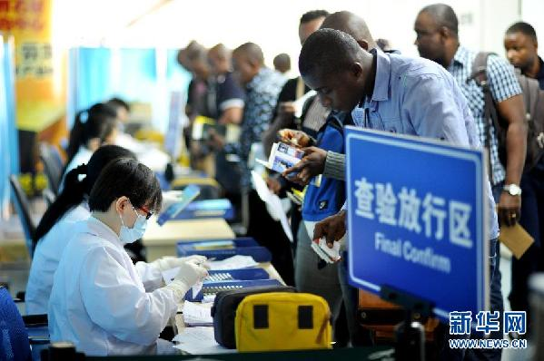 China city distributes free cellphones to Ebola zone arrival
