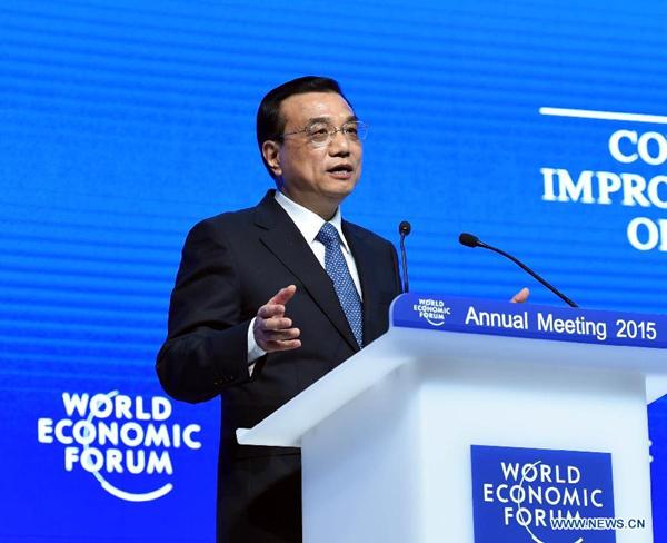 国务院总理李克强当地时间21日下午在瑞士达沃斯出席世界经济论坛2015年年会,并在全会上发表特别致辞。[新华社]
