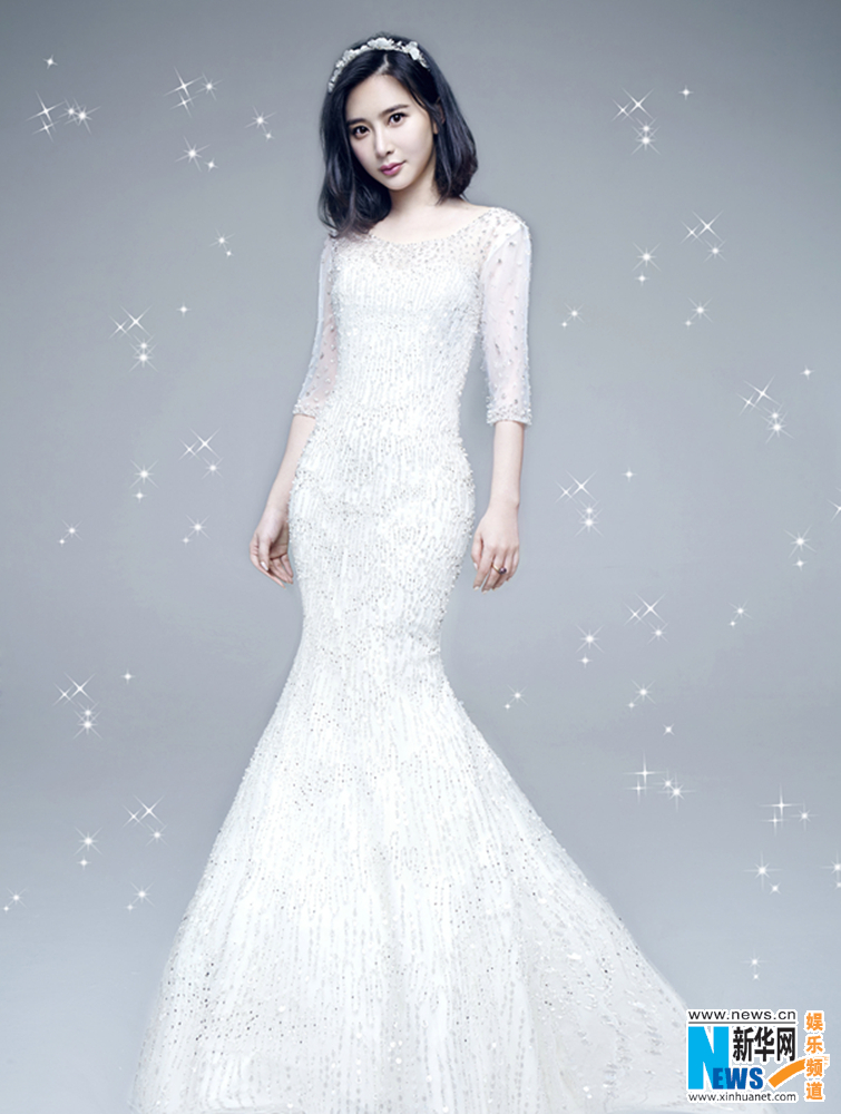 Actress Xiong Naijin dresses in wedding gowns- China.org.cn