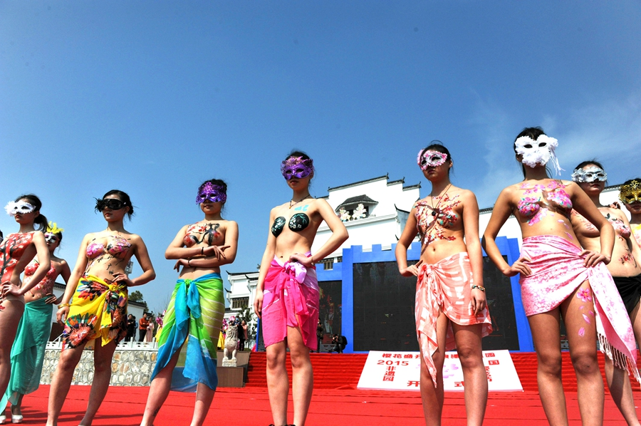Hefei cherry blossom festival features nude body paintings