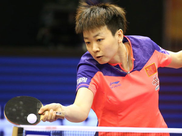 China's Mu Zi hopes to shine, while keeping a low key after two qualification wins at the 53rd World Table Tennis Championships in Suzhou on Sunday. [Xinhua]