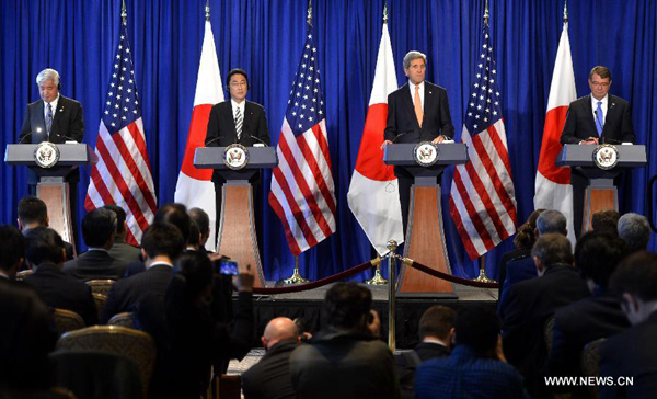 (R to L) U.S. Defense Secretary Ashton Carter, U.S. Secretary of State John Kerry, Japanese Foreign Minister Fumio Kishida and Japanese Defense Minister Gen Nakatani attend a press conference in New York, the United States, on April 27, 2015. U.S. and Japan announced on Monday new guidelines for bilateral defense cooperation, allowing Japan's self defense forces to take on more ambitious global role that the Shinzo Abe administration has been seeking. [Photo/Xinhua]