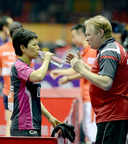 Ni Xialian (L), the oldest women player at 51, bowed out of the world table tennis championships on Wednesday with her head held high, saying 'a bit extra strength' would have sent her farther. [Xinhua]