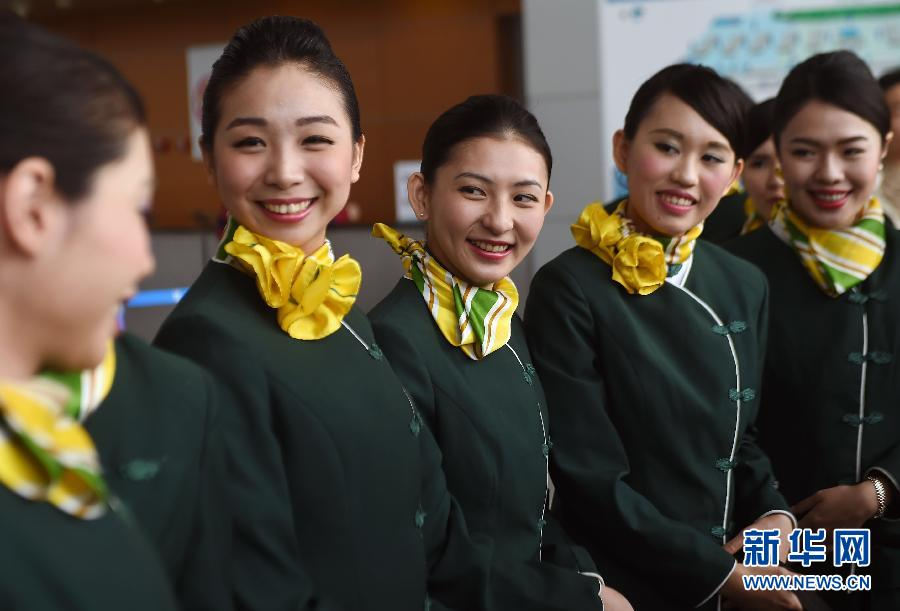 A group of flight attendants from Taiwan prepare for their first flight service on Shanghai's budget carrier Spring Airlines on May 7, 2015. [Photo: Xinhua]