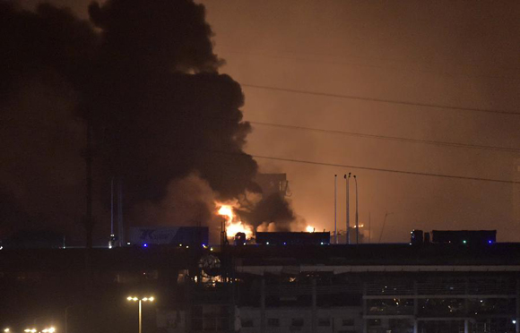Smoke and fire are seen after an explosion in the Binhai New Area in north China's Tianjin Municipality on Aug. 13, 2015. An explosion rocked the Binhai New Area in north China's Tianjin Municipality at around 11:30 p.m. Wednesday. The cause and casualties are not immediately known. [Photo/Xinhua]