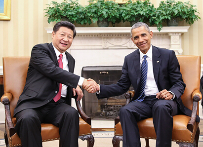 China's President Xi Jinping talks with US President Barack Obama in Washington, the United States on Sept. 25, 2015. [Photo/Xinhua]