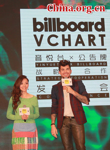Chinese singer Jane Zhang and American singer Adam Lambert speak at an event to unveil the collaboration between Yinyuetai and Billboard to create a Billboard China chart in Beijing, on Nov. 9, 2015. [Photo by Zhang Rui/China.org.cn]