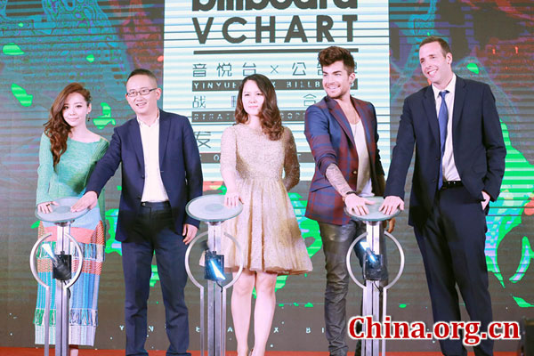 Chinese singer Jane Zhang, Yinyuetai CEO Zhang Dou, Yinyuetai's co-founder Shi Ying, American singer Adam Lambert, and Jonathan Serbin, head of Asia for Billboard, unveil the collaboration between Yinyuetai and Billboard to create Billboard China chart in Beijing, on Nov. 9, 2015. [Photo/China.org.cn]
