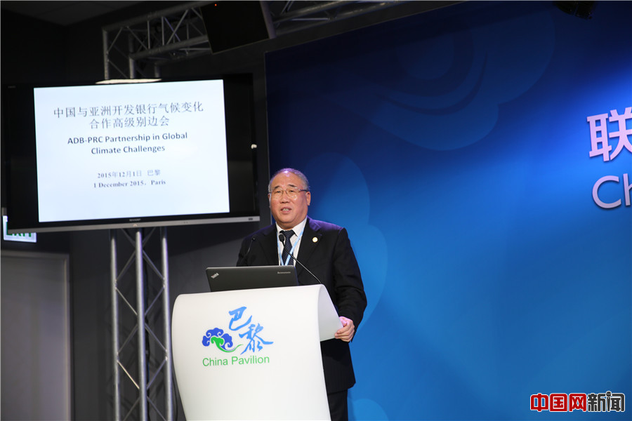 Xie Zhenhua, China's climate change special representative, speaks on the sidelines of the Paris Climate Change conference on Dec. 1, 2015. [Photo/China.org.cn]