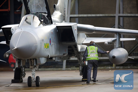 Pilots and ground crew prepare a Tornado GR4 aircraft at the British Royal Air Force airbase RAF Marham in Norfolk in east England on December 2, 2015 [Photo/Xinhua]