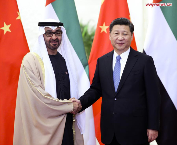 Chinese President Xi Jinping (R) meets with Sheikh Mohammed Bin Zayed Al-Nahyan, crown prince of Abu Dhabi of the United Arab Emirates, in Beijing, capital of China, Dec. 14, 2015. [Photo/Xinhua]