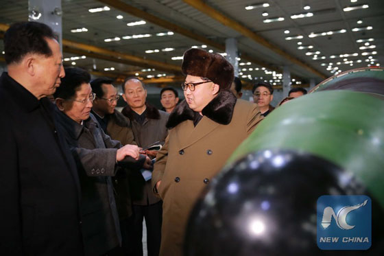 Photo provided by Korean Central News Agency (KCNA) on March 9, 2016 shows top leader of the Democratic People's Republic of Korea (DPRK) Kim Jong Un recently meeting with the scientists and technicians in the field of nuclear weapons and guiding the work for boosting the nuclear arsenal. [Photo/Xinhua]
