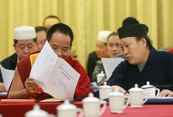 The 11th Panchen Lama, Bainqen Erdini Qoigyijabu, attends a panel discussion of the 12th National Committee of the Chinese People's Political Consultative Conference on Sunday. [Zou Hong / China Daily]