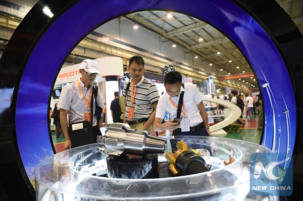 People visit products made by robots during an expo in Yinchuan, northwest China's Ningxia Hui Autonomous Region, July 10, 2015. (Xinhua/Wang Peng)