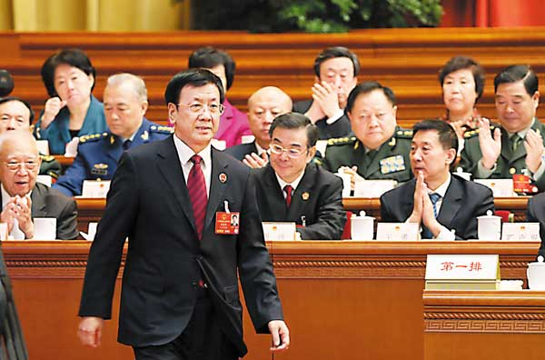 Cao Jianming, prosecutor general at the Supreme People's Procuratorate, prepares to deliver a speech in the Great Hall of the People in Beijing on Sunday. [China Daily]