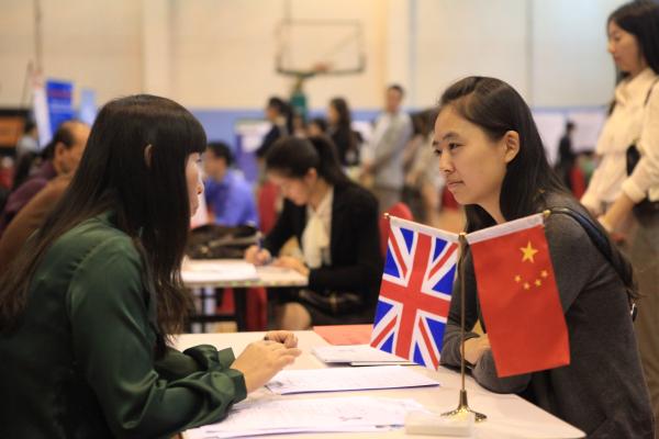 An overseas returnee attends an interview at a job fair in Beijing. [File photo]