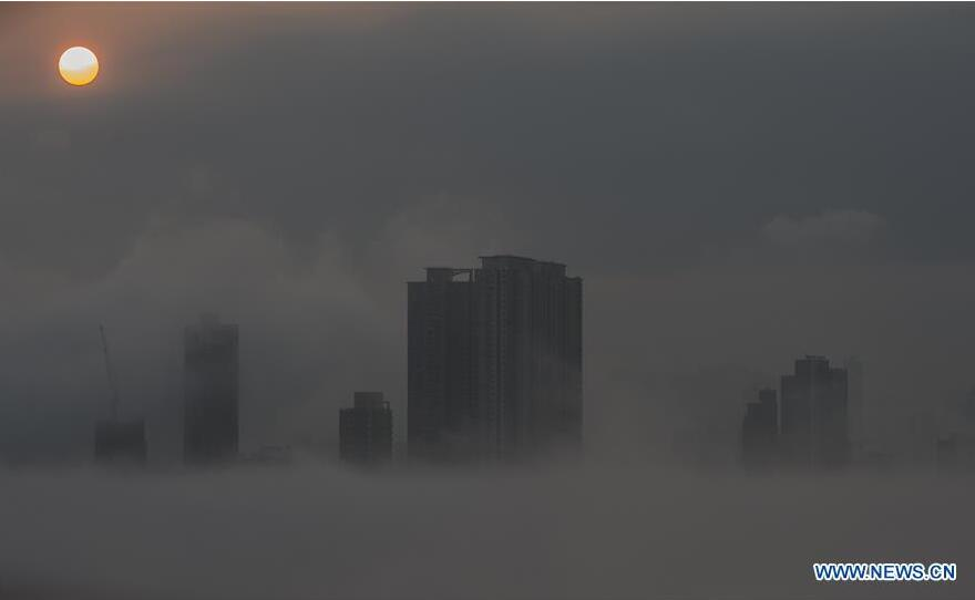 The city landscape is seen engulfed in heavy fog in Hong Kong, south China, April 6, 2016. (Xinhua/Lui Siu Wai)
