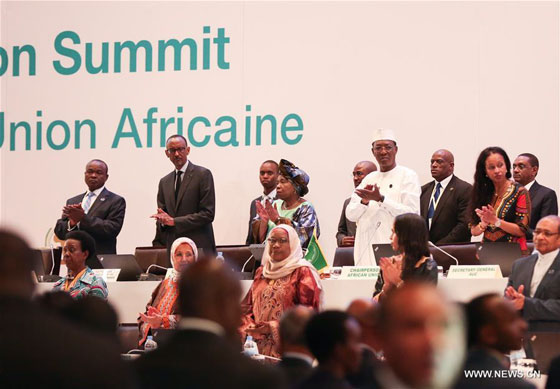 President of the Republic of Chad and rotating African Union chairperson Idriss Deby (4th R, on stage), President of Rwanda Paul Kagame (2nd L, on stage), Chairperson of the African Union Commission (AUC) Nkosazana Dlamini Zuma (4th L, on stage) and Deputy Chairperson of the AUC Erastus Mwencha (1st L, on stage) attend the opening ceremony of the 27th ordinary session of the AU Heads of States, in Kigali, Rwanda, July 17, 2016. [Photo/Xinhua]
