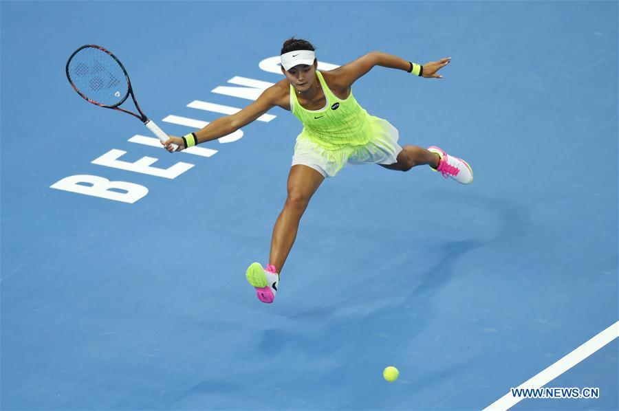 China's Wang Yafan returns the ball during the women's singles second round match against Czech Republic's Petra Kvitova at the China Open tennis tournament in Beijing, capital of China, Oct. 4, 2016. [Photo/Xinhua]