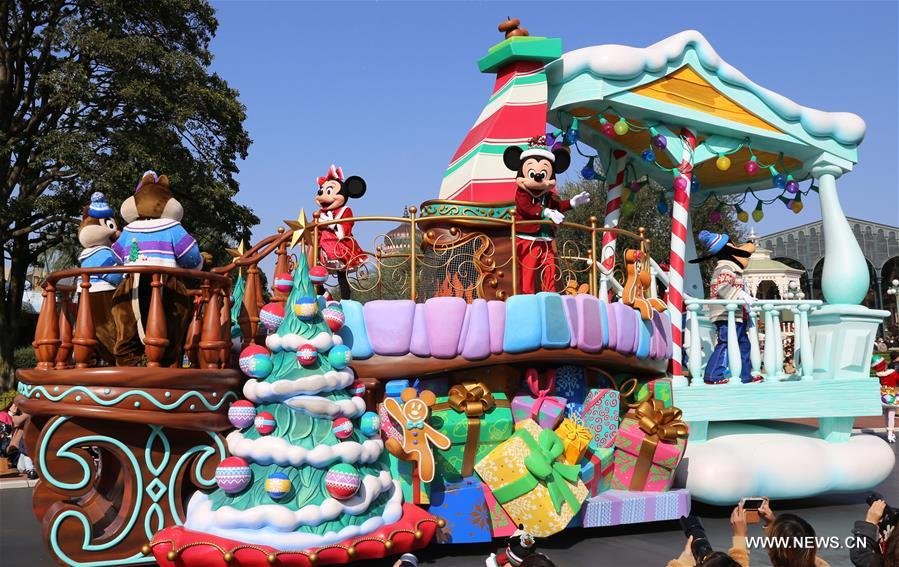disney cartoon characters stand on a float during the theme parks christmas parade at tokyo disneyland in suburban tokyo japan on nov 7 2016